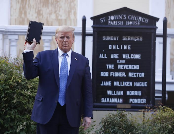 U.S. President Donald Trump poses with a bible outside St. John's Episcopal Church after a news conference in the Rose Garden of the White House in Washington, D.C., U.S., on Monday, June 1, 2020. (Shawn Thew/EPA/Bloomberg via Getty images)
