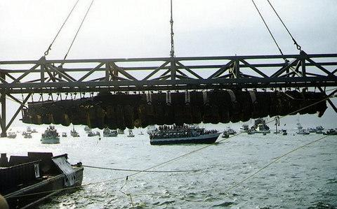 The submarine being raised in 2000Credit: US Navy