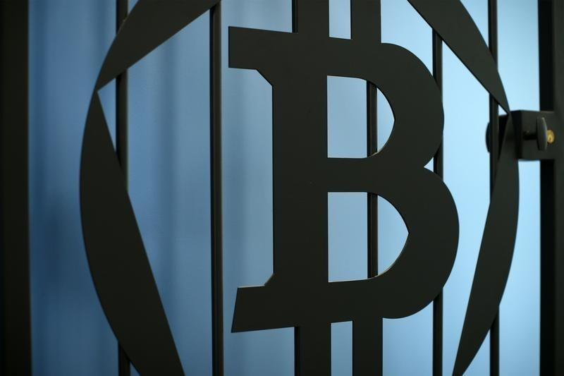 The logo of Bitcoin (virtual currency) is pictured on a door in an illustration picture taken at La Maison du Bitcoin in Paris