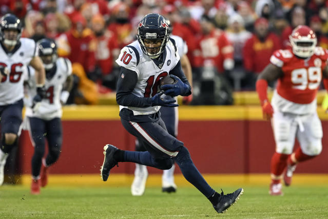 FILE - In this Jan. 12, 2020, file photo, Houston Texans wide receiver DeAndre Hopkins (10) runs against the Kansas City Chiefs during the second half of an NFL football game in Kansas City, Mo. The Arizona Cardinals have acquired three-time All-Pro receiver DeAndre Hopkins in a trade that will send running back David Johnson and draft picks to the Houston Texans, a person familiar with the situation told The Associated Press. The person spoke to the AP on condition of anonymity Monday, March 16, 2020, because the trade hasn't been officially announced. (AP Photo/Reed Hoffmann, File)