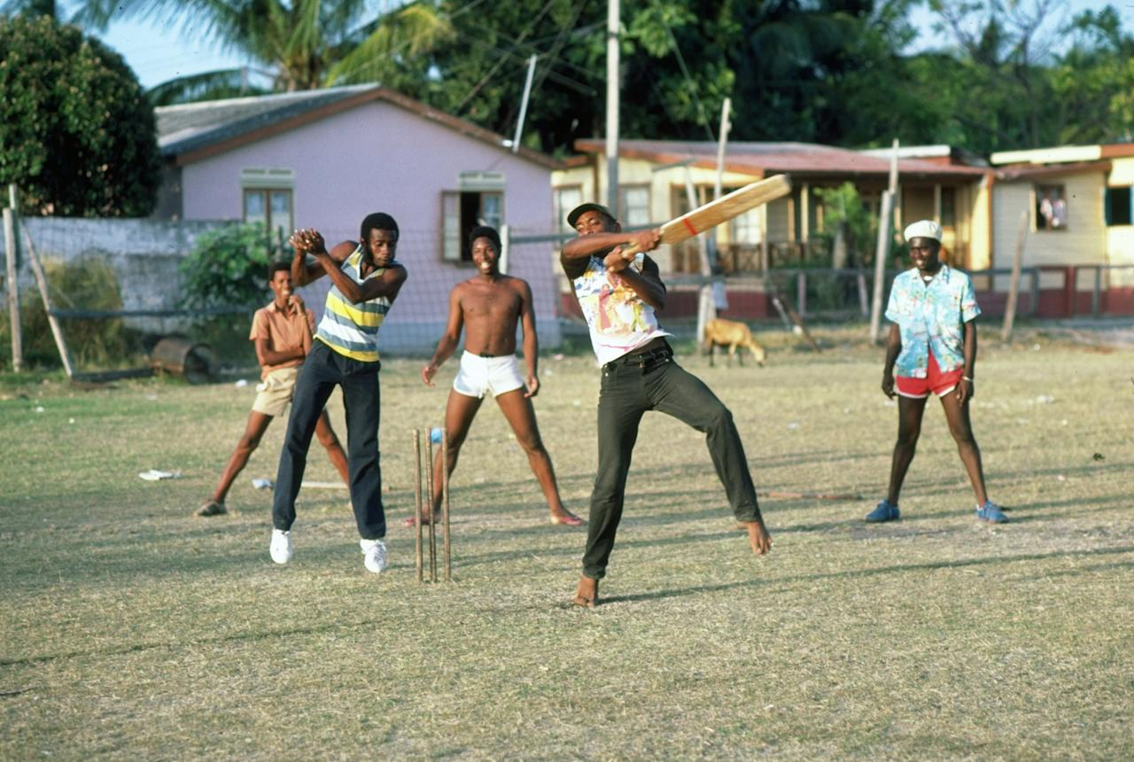 Mar 1981:  Children and adults play a game of softball cricket in Barbados, West Indies.   \ Mandatory Credit: Adrian  Murrell/Allsport