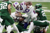 Buffalo Bills' Zack Moss, center, tries to power through New York Jets defenders during the second half of an NFL football game, Sunday, Oct. 25, 2020, in East Rutherford, N.J. (AP Photo/Frank Franklin II)