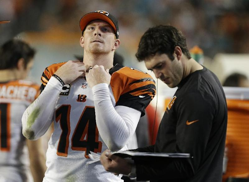 Cincinnati Bengals quarterback Andy Dalton (14) looks up before looking at play copies on the sideline during the first half of an NFL football game against the Miami Dolphins, Thursday, Oct. 31, 2013, in Miami Gardens, Fla. (AP Photo/Lynne Sladky)