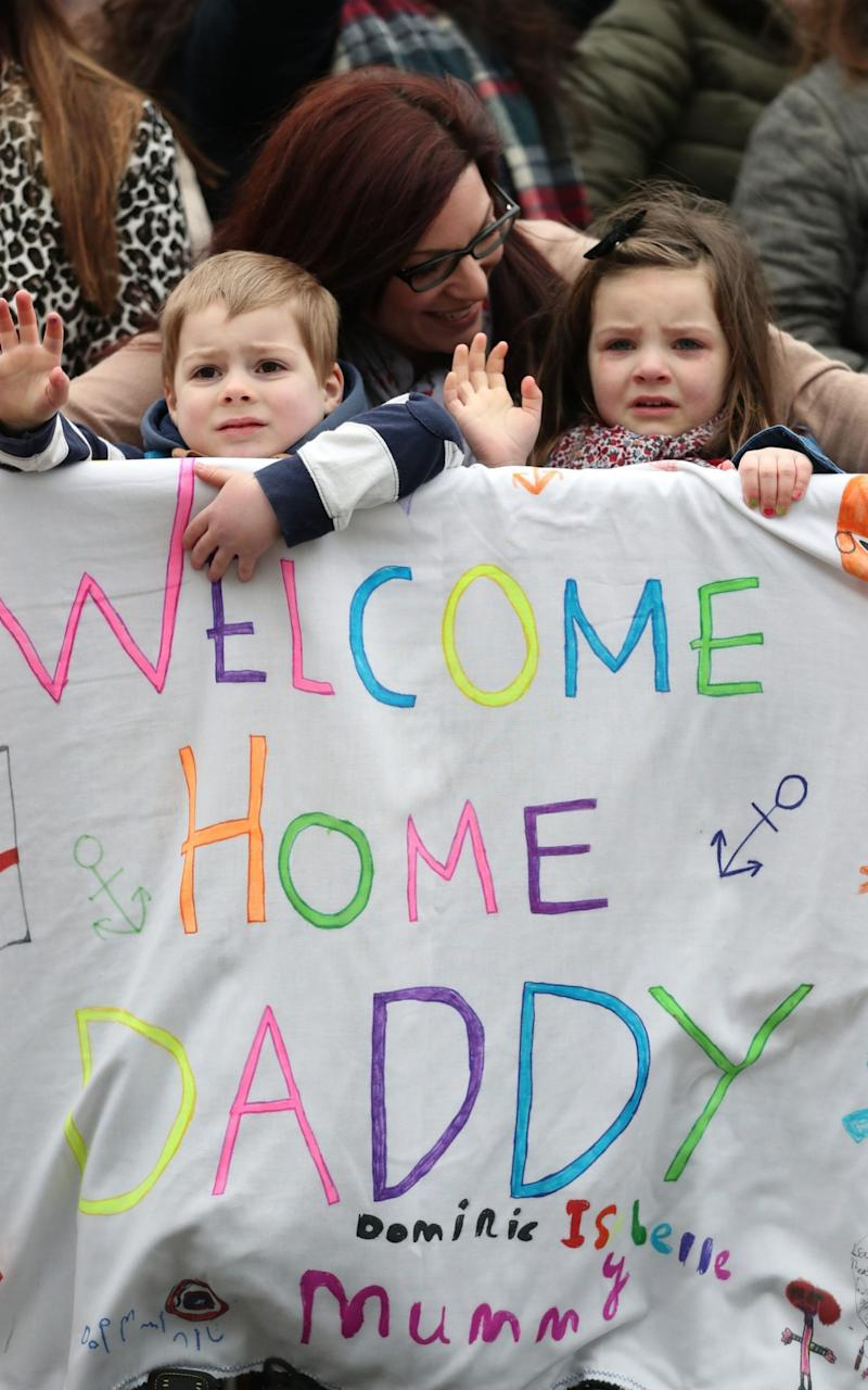 Luisa Jeffrey from Sussex, and her daughter Isabelle, 5, and son Dominic, 4, await Adam Jeffrey's arrival - Credit: Andrew Matthews/PA