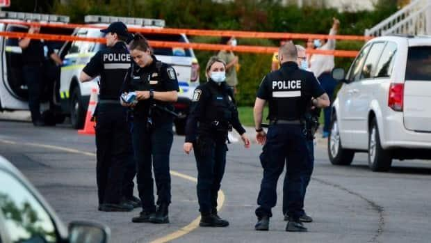 While police investigated after a woman lost control of her vehicle and collided with a crowd Monday outside a polling station in Montreal, ambulance workers treated people for non-life-threatening injuries. (Jean-Claude Taliana/Radio-Canada - image credit)
