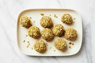 """These sweet picnic snacks are made with no additional sugar, just <a href=""""https://www.epicurious.com/ingredients/how-to-buy-and-store-medjool-dates-deglet-noor-recipes-article?mbid=synd_yahoo_rss"""" rel=""""nofollow noopener"""" target=""""_blank"""" data-ylk=""""slk:dates"""" class=""""link rapid-noclick-resp"""">dates</a>, milk, pistachios, and almonds. <a href=""""https://www.epicurious.com/recipes/food/views/khajur-ladu-date-pistachio-and-almond-morsels-nandita-godbole?mbid=synd_yahoo_rss"""" rel=""""nofollow noopener"""" target=""""_blank"""" data-ylk=""""slk:See recipe."""" class=""""link rapid-noclick-resp"""">See recipe.</a>"""