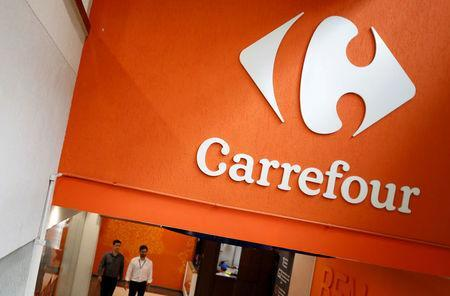 FILE PHOTO: The Carrefour logo is pictured in a supermarket in Sao Paulo, Brazil November 9, 2017. REUTERS/Nacho Doce/File photo
