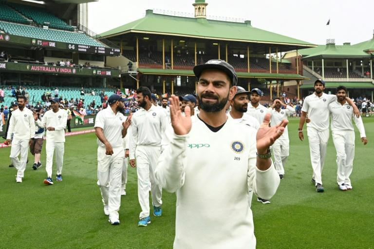 India's captain Virat Kohli leads his team in celebration after winning the fourth Test against Australia at the Sydney Cricket Ground in January this year
