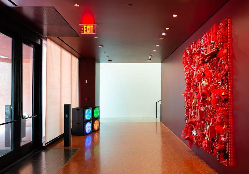 The entry is a deep red, designed by Adjaye to allow visitors' eyes to adjust from the bright Texas sun.