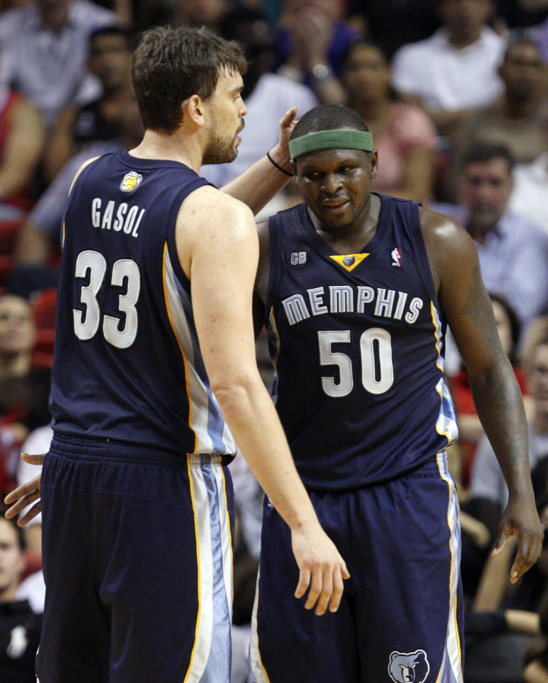 Memphis Grizzlies forward Zach Randolph (50) is congratulated by center Marc Gasol (33) after Randolph made a shot during the second half of an NBA basketball game against the Miami Heat, Friday, April 6, 2012 in Miami. Randolph had 14 points and 14 rebounds off the bench, and Gasol scored 10 points as the Grizzlies defeated the Heat 97-82. (AP Photo/Wilfredo Lee)