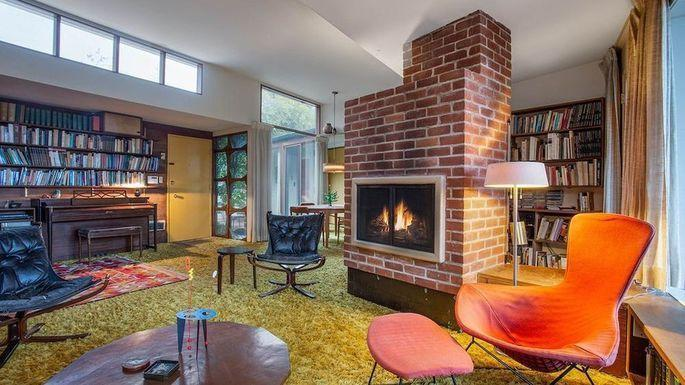 The perfectly preserved 1950's living area inside a Bentwood, Los Angeles home, complete with a classic brick fireplace.