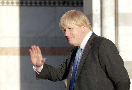 Britain's Foreign Secretary Boris Johnson gestures as he poses for a family photo during a G7 for foreign ministers in Lucca