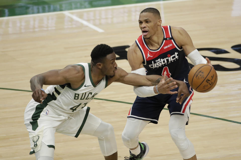 Washington Wizards' Russell Westbrook (4) is fouled by Milwaukee Bucks' Thanasis Antetokounmpo (43) during the first half of an NBA basketball game Wednesday, May 5, 2021, in Milwaukee. (AP Photo/Aaron Gash)