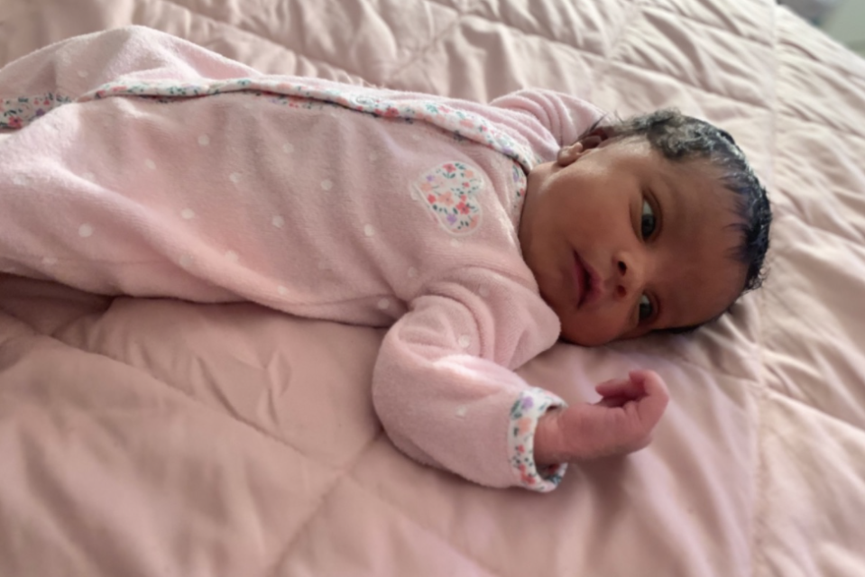 Photo shows baby London Martin in a pink night gown.