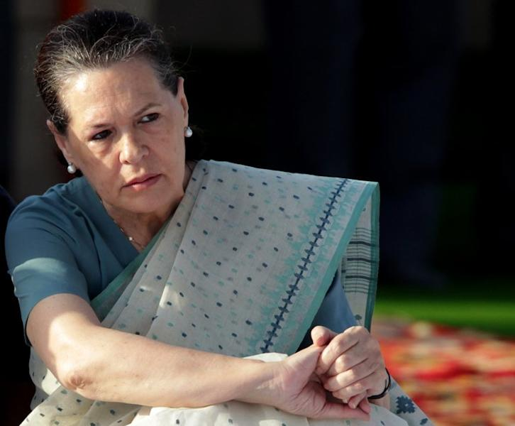 """Sonia Gandhi pays her respects at Mahatma Gandhi's memorial in New Delhi, on October 2, 2011. The Italian-born head of India's ruling party has accused Rome of an unacceptable """"betrayal"""" as she waded into a bitter dispute over two marines who have skipped bail"""