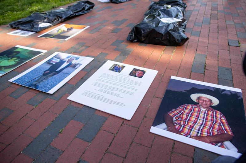 Progressive activists outside the White House in Washington D.C. lay body bags and photos of loved ones killed by the coronavirus on May 20, 2020 as part of nationwide demonstrations against President Donald Trump's handling of the pandemic, which has killed nearly 100,00 people in the U.S. (Yilmaz Akin/Subminimal for Care in Action)