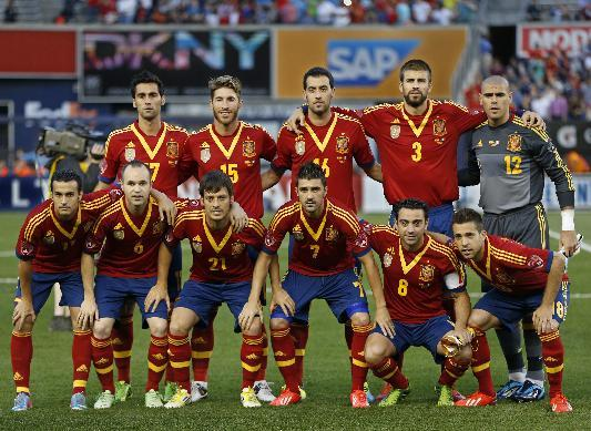 In this June 11, 2013 file photo, Spain soccer team poses prior to the start  an international friendly soccer match against Ireland at Yankee Stadium in New York. Foreground from left, Pedro, Andres Iniesta, David Silva, Davis Villa, Xavi Hernadez, Jordi Alba. Background from left, Alvaro Arbeloa, Sergio Ramos, Sergio Busquets, Gerard Pique, Victor Valdes