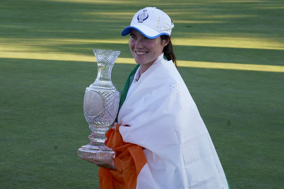 Europe's Leona Maguire holds the trophy after their team defeated the United States at the Solheim Cup golf tournament, Monday, Sept. 6, 2021, in Toledo, Ohio. (AP Photo/Carlos Osorio)