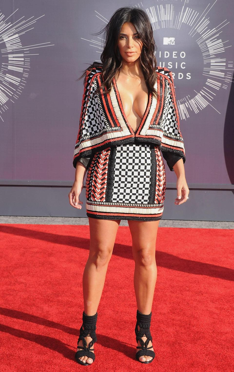 The Kardashian-Jenner women love Balmain. Kim turned more than a few heads in a vibrant cape number from the iconic French fashion house.