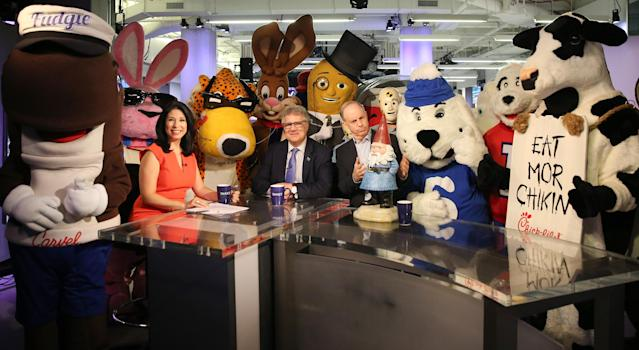 <p>Advertising Week's Matt Scheckner, center, poses for a photo with Yahoo Finance Editor in Chief Andy Serwer, Yahoo Finance Anchor and Reporter Alexis Christoforous and a group of company mascots brought in as interns for the day at Yahoo Studios in New York City on Sept. 25, 2017. (Photo: Gordon Donovan/Yahoo News) </p>