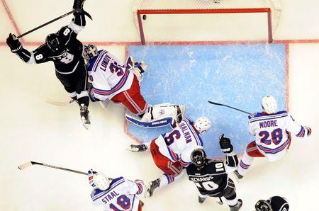 Jun 4, 2014; Los Angeles, CA, USA; Los Angeles Kings defenseman Drew Doughty (8) reacts after scoring a goal against New York Rangers goalie Henrik Lundqvist (30) during the first period in game one of the 2014 Stanley Cup Final at Staples Center. Mandatory Credit: Richard Mackson-USA TODAY Sports