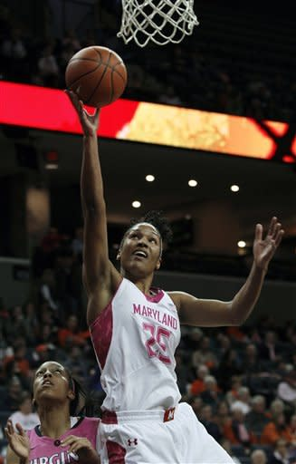 Maryland forward Alyssa Thomas goes to the basket over Virginia guard Ataira Franklin during the first half of an NCAA college basketball game in Charlottesville, Va., Sunday, Feb. 17, 2013. (AP Photo/Norm Shafer)