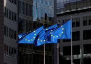 FILE PHOTO: FILE PHOTO: European Union flags flutter outside the European Commission headquarters in Brussels