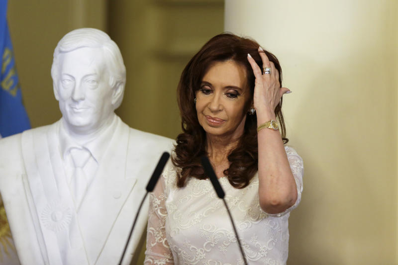 FILE - In this Dec. 9, 2015 file photo, Argentina's President Cristina Fernandez takes part in an unveiling a bust of her late husband, and former President Nestor Kirchner, at the presidential palace in Buenos Aires, Argentina. An Argentine federal judge on Thursday, Dec. 7, 2017, accused Fernandez of the crime of treason as he asked lawmakers to remove Fernandez's immunity from prosecution as a senator. (AP Photo/Ricardo Mazalan, File)