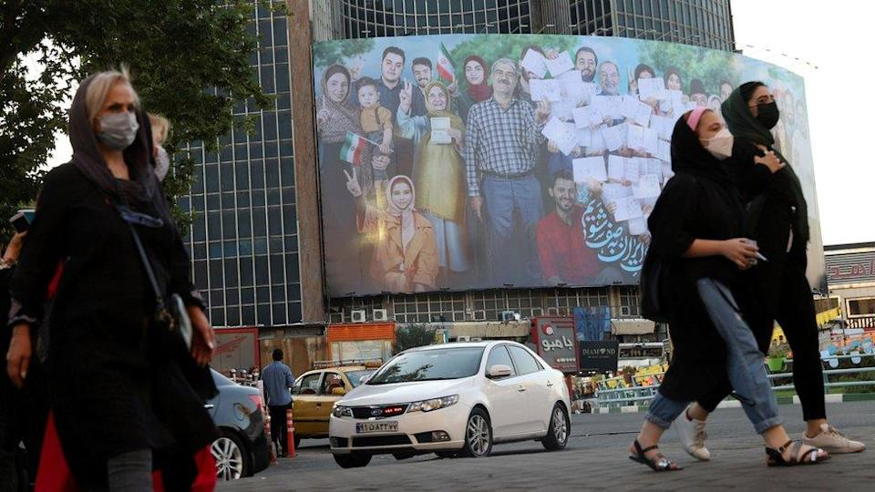 A banner for the presidential election is seen in Valiasr square in Tehran, Iran (16 June 2021)