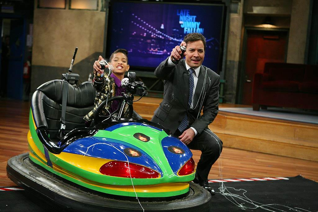 The night before, Jimmy <i>looked</i> more demure, but he still got a little wacky when Willow Smith stopped by and the two rode bumper cars and shot silly string! (12/6/2011)
