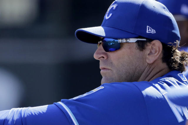 FILE - In this Feb. 24, 2020, file photo, Kansas City Royals manager Mike Matheny watches from the dugout during the second inning of a spring training baseball game against the San Diego Padres in Surprise, Ariz. The Royals had an entire offseason and most of spring training to get to know Mike Matheny. But one unintended consequence of the coronavirus pandemic is they've gotten to know their new manager better than they could ever have imagined. (AP Photo/Charlie Riedel, File)