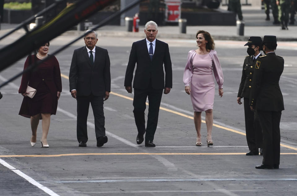 Cuba's first lady Lis Cuesta, from left, Mexico's President Andres Manuel Lopez Obrador, Cuba's President Miguel Diaz-Canel and Mexico's first lady Beatriz Gutierrez Muller, take part in Mexico's Independence Day celebrations, in the Zocalo in Mexico City, Thursday, Sept. 16, 2021. (AP Photo/Marco Ugarte)