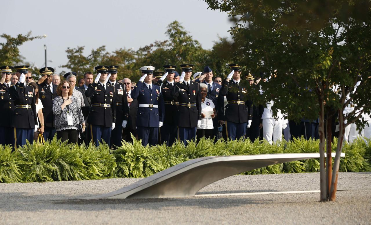 Participants stand at attention during an event on the 12th anniversary of the 9/11 attacks, at the Pentagon memorial near Washington September 11, 2013. Bagpipes, bells and a reading of the names of the nearly 3,000 people killed when hijacked jetliners crashed into the World Trade Center, the Pentagon and a Pennsylvania field marked the 12th anniversary of the September 11 attacks in 2001. REUTERS/Jason Reed (UNITED STATES - Tags: POLITICS ANNIVERSARY)