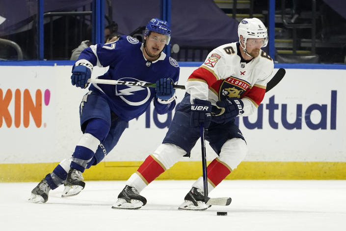 Florida Panthers defenseman Anton Stralman (6) skates around Tampa Bay Lightning center Yanni Gourde (37) during the second period in Game 4 of an NHL hockey Stanley Cup first-round playoff series Saturday, May 22, 2021, in Tampa, Fla. (AP Photo/Chris O'Meara)