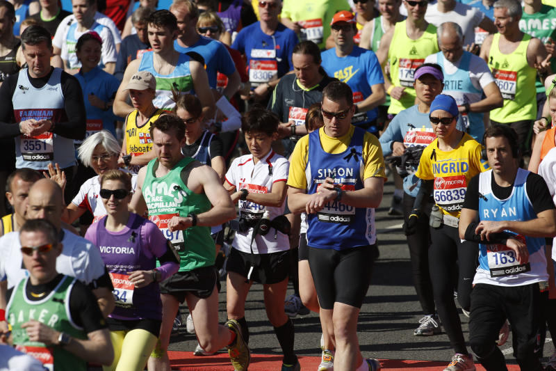 Runners wear black ribbons in memory of the victims of Boston Marathon bombings start the race during the London Marathon, London, Sunday, April 21, 2013. (AP Photo/Sang Tan)