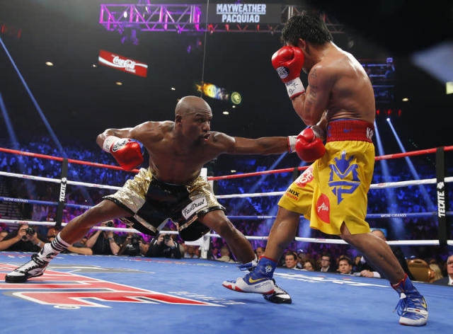 Mayweather, Jr. of the U.S. stays low against Pacquiao of the Philippines in the eighth round during their welterweight title fight in Las Vegas