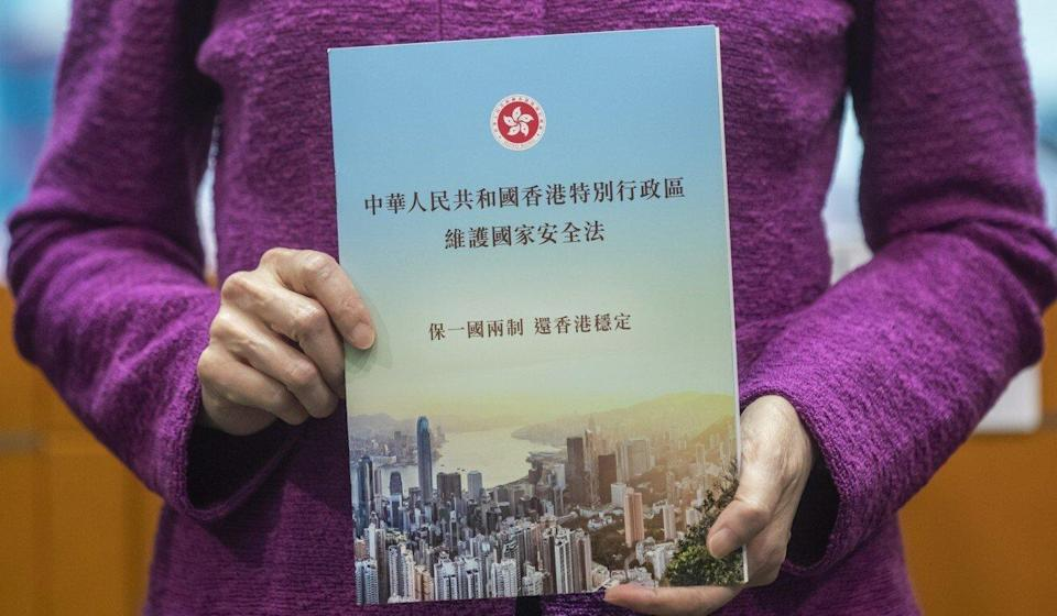 City leader Carrie Lam holds a copy of the new national security law at a press conference on July 1, 2020. Photo: Bloomberg