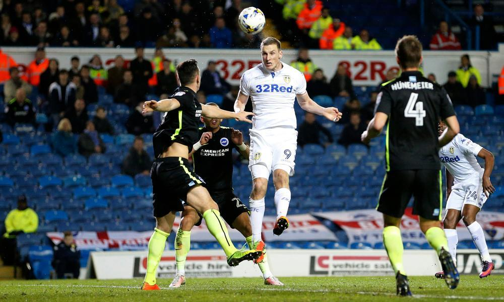 Chris Wood scores Leeds' first goal in the 2-0 win over Brighton with a towering header