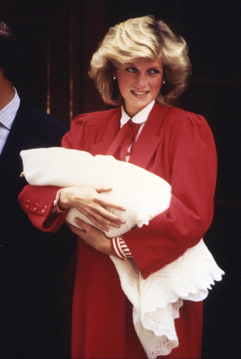 <p>Stepping out to present her second son Prince Harry to the world, Diana sported a fuller '80s-inspired blow dry.<br><em>[Photo: PA]</em> </p>