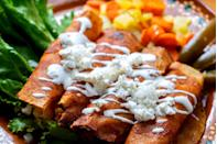 """<p>In <a href=""""https://www.thedailymeal.com/eat/best-mexican-restaurant-every-state-gallery?referrer=yahoo&category=beauty_food&include_utm=1&utm_medium=referral&utm_source=yahoo&utm_campaign=feed"""" rel=""""nofollow noopener"""" target=""""_blank"""" data-ylk=""""slk:the best Mexican restaurants"""" class=""""link rapid-noclick-resp"""">the best Mexican restaurants</a>, you will surely find a classic take or modern spin on the enchilada. This simple family recipe results in rolled-up tortillas stuffed with crumbled cheese and covered in chile sauce.</p> <p><strong><a href=""""https://www.thedailymeal.com/best-recipes/queso-fresco-enchiladas?referrer=yahoo&category=beauty_food&include_utm=1&utm_medium=referral&utm_source=yahoo&utm_campaign=feed"""" rel=""""nofollow noopener"""" target=""""_blank"""" data-ylk=""""slk:For the Enchiladas recipe, click here."""" class=""""link rapid-noclick-resp"""">For the Enchiladas recipe, click here.</a> </strong></p>"""