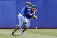 Toronto Blue Jays' Lourdes Gurriel Jr., drops a fly ball hit by Philadelphia Phillies' Rafael Marchan during the fourth inning of a baseball game Sunday, May 16, 2021, in Dunedin, Fla. (AP Photo/Mike Carlson)