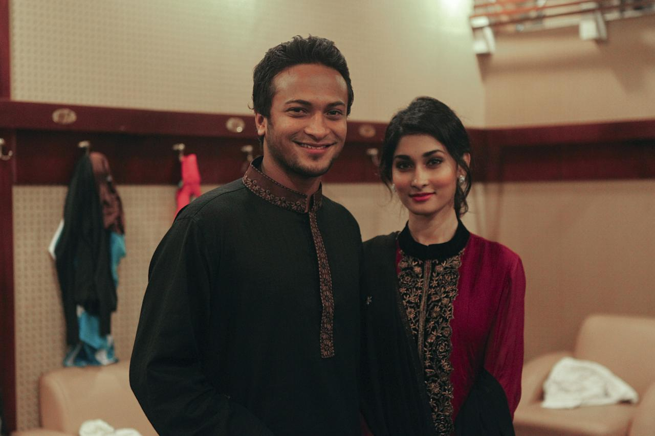 In this photo taken on December 10, 2012, Bangladesh's cricket player Shakib al Hasan (L) and his girlfriend Umme Ahmed Shishir in Dhaka. Bangladesh's star player and formerly the nation's most eligible bachelor Shakib al Hasan is set to marry his United States national girlfriend in a ceremony timed for 12.12.12, a friend and local reports said. The 25-year-old cricketer, the world's leading all-rounder, will tie the knot the with an United States national of Bangladeshi origin in a private family ceremony organised on the once-in-a-lifetime date, his friend told AFP. AFP PHOTO/ STR