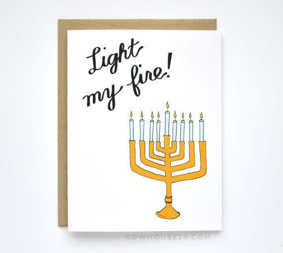 "<i>Buy it from <a href=""https://www.etsy.com/listing/166650623/funny-hanukkah-card-sexy-hanukkah-card"" rel=""nofollow noopener"" target=""_blank"" data-ylk=""slk:RowHouse14 on Etsy"" class=""link rapid-noclick-resp"">RowHouse14 on Etsy</a>&nbsp;for&nbsp;$4.50.</i>"