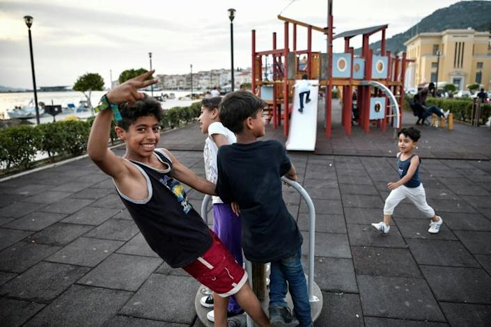 """Local Greeks express sympathy for the migrants, not least the children, with one noting they are """"treated like animals"""" -- but others complain that """"migrant kids swarm the playgrounds"""" (AFP Photo/Louisa Gouliamaki)"""