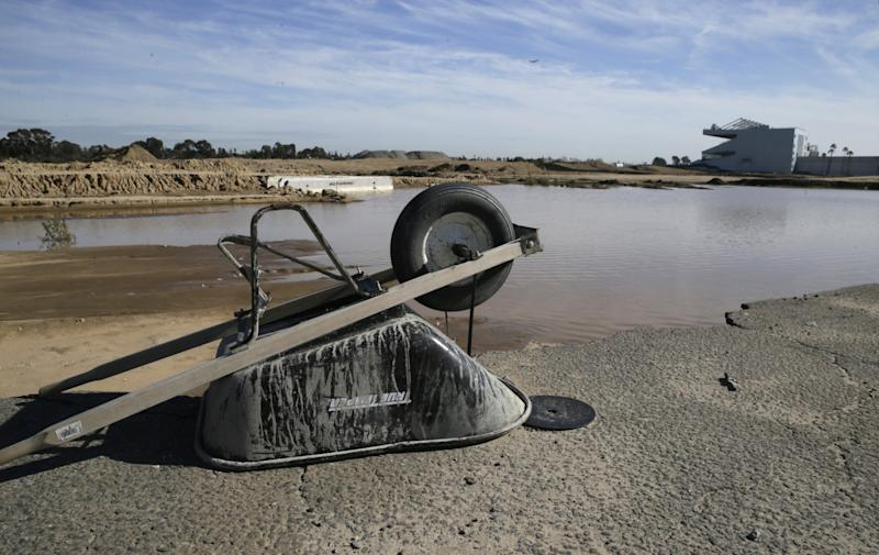 A wheelbarrow sits at the site of the former Hollywood Park in Inglewood, Calif., where a stadium for NFL football Los Angeles Rams is being built. The opening date for stadium, under construction in Inglewood, Calif., has been pushed back one year to 2020 after heavy rains halted the project for two months. (AP)
