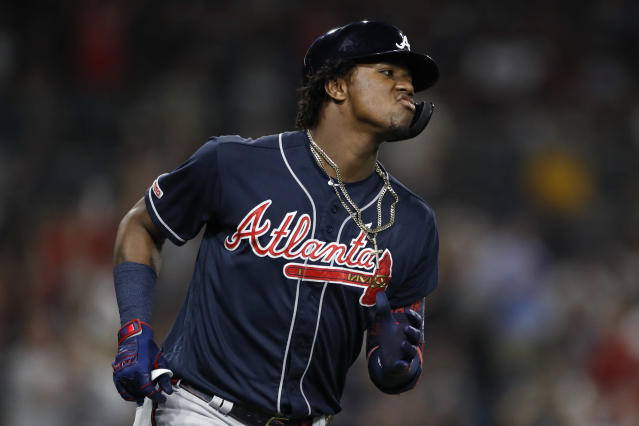 Atlanta Braves' Ronald Acuna Jr. reacts after hitting a home run during the fifth inning of the team's baseball game against the San Diego Padres, Friday, July 12, 2019, in San Diego. (AP Photo/Gregory Bull)