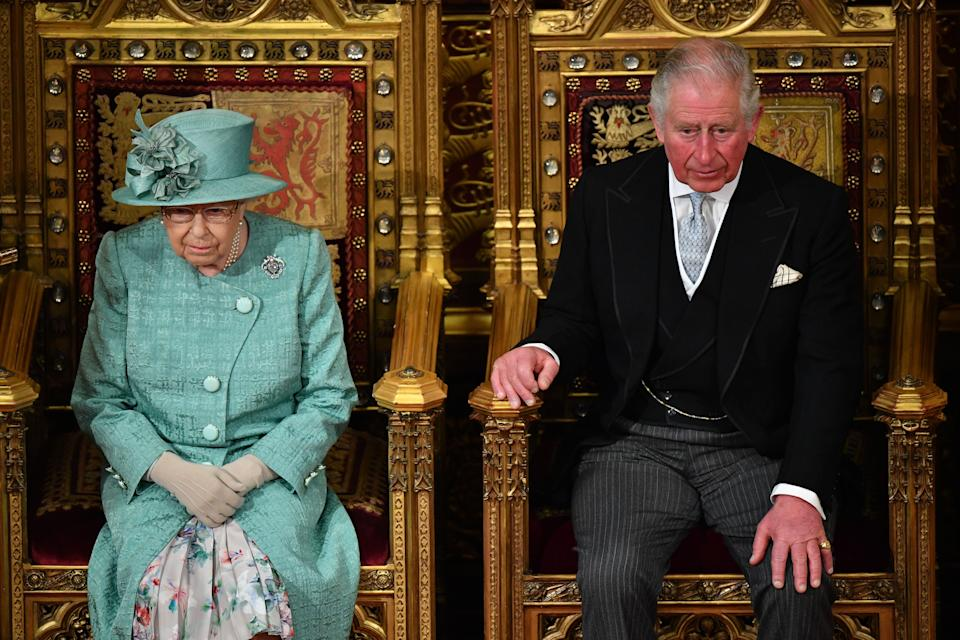 Britain's Prince Charles, Prince of Wales (R) sits with Britain's Queen Elizabeth II on the The Sovereign's Throne in the House of Lords chamber, during the State Opening of Parliament in the Houses of Parliament in London on December 19, 2019. - The State Opening of Parliament is where Queen Elizabeth II performs her ceremonial duty of informing parliament about the government's agenda for the coming year in a Queen's Speech. (Photo by Leon Neal / POOL / AFP) (Photo by LEON NEAL/POOL/AFP via Getty Images)