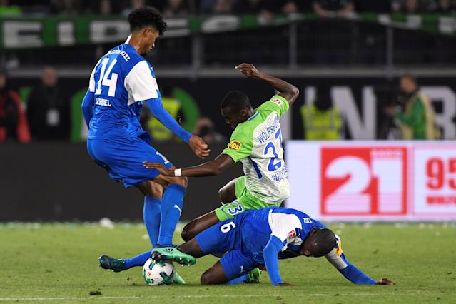 Soccer Football - Bundesliga Promotion/Relegation Playoff First leg - VfL Wolfsburg v Holstein Kiel - Volkswagen Arena, Wolfsburg, Germany - May 17, 2018 Wolfsburg's Josuha Guilavogui in action with Holstein Kiel's David Kinsombi and Aaron Seydel REUTERS/Fabian Bimmer DFL RULES TO LIMIT THE ONLINE USAGE DURING MATCH TIME TO 15 PICTURES PER GAME. IMAGE SEQUENCES TO SIMULATE VIDEO IS NOT ALLOWED AT ANY TIME. FOR FURTHER QUERIES PLEASE CONTACT DFL DIRECTLY AT + 49 69 650050
