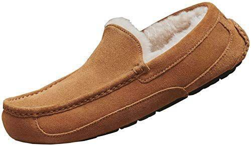 """<p><strong>UGG</strong></p><p>amazon.com</p><p><strong>$109.95</strong></p><p><a href=""""https://www.amazon.com/dp/B077JGLLXB?tag=syn-yahoo-20&ascsubtag=%5Bartid%7C2140.g.32268112%5Bsrc%7Cyahoo-us"""" rel=""""nofollow noopener"""" target=""""_blank"""" data-ylk=""""slk:Shop Now"""" class=""""link rapid-noclick-resp"""">Shop Now</a></p><p>Slippers are a classic gift, but these ones from UGG are made from a cool suede, so he'll be looking stylish and feeling good even when he's just grabbing the mail. </p>"""
