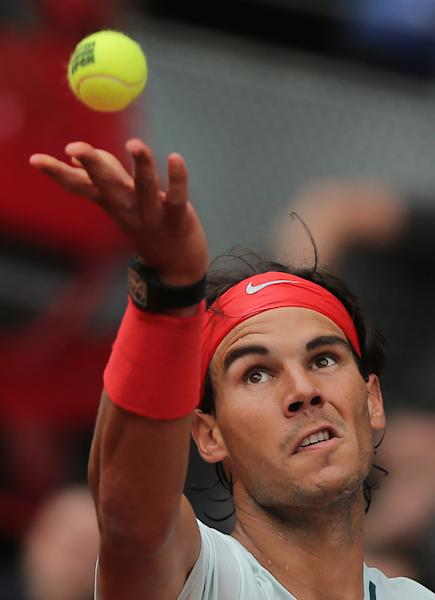 Rafael Nadal from Spain serves during the match against Benoit Paire from France at the Madrid Open tennis tournament, in Madrid, Wednesday, May 8, 2013. (AP Photo/Andres Kudacki)